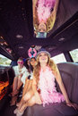 Frivolous women in a limousine on night out Stock Photography
