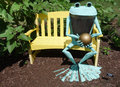 Frog bronze statue on yellow bench this cute is deep in thought its in airlie garden wilmington north carolina Royalty Free Stock Image