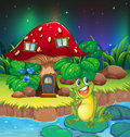 A frog sitting on a waterlily near the mushroom house illustration of Stock Photo