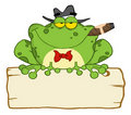 Frog smoking a cigar on a wood sigh Stock Photography