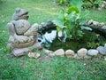 Frog statue in garden park or home Stock Photos