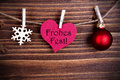 Frohes fest in a heart the german words which means merry christmas tag hanging on line on wood Royalty Free Stock Photos