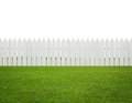 Front or back yard, white wooden fence on the grass isolated on Royalty Free Stock Photo