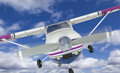 Front of Cessna 172 Single Propeller Airplane In The Sky Royalty Free Stock Photo