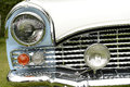 Front of classic car showing headlamps and radiator grill Royalty Free Stock Photo