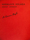 Front cover of aged of sherlock holmes short stories red volume carrying the title and the signature Stock Photo