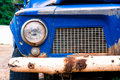The front detail of old rusted blue truck Royalty Free Stock Photo