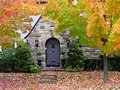 Front door in autumn with falling leaves Royalty Free Stock Photos
