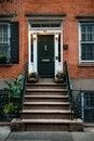 Front Door of a Beautiful Georgian Era English Manhattan Town House. New York City home building entrance Royalty Free Stock Photo