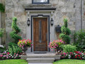 Front door with flowers Royalty Free Stock Photo