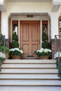 Front door, front view of front brown door Royalty Free Stock Photo