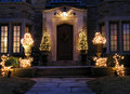 Front door with holiday lights and shrubbery Royalty Free Stock Images