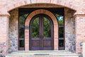 Front door home arch stone wood in design with brickwork curved around the doors design Stock Photography