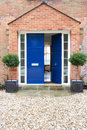 Front door of modern house Photographie stock libre de droits