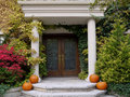 Front door with pumpkins Royalty Free Stock Images