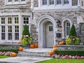 Front door with pumpkins as a fall decoration Royalty Free Stock Image