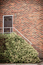 Front door of red brick house Royalty Free Stock Photo