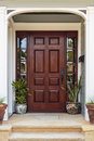 Front door, view of front door accented with plants Royalty Free Stock Photo