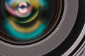Front element of a camera lens macro shot with beautiful color lights reflections Royalty Free Stock Images