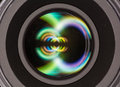 Front element of a camera lens macro shot with beautiful color lights reflections Stock Photography