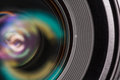 Front element of a camera lens macro shot with beautiful color lights reflections Royalty Free Stock Image