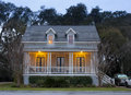 Front elevation of house at twilight Royalty Free Stock Photo