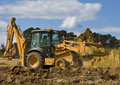 Front end loader with backhoe Royalty Free Stock Photos