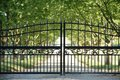 Front gate large black metal at the entrance to a country estate Royalty Free Stock Photo