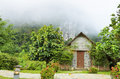 Front home in the morning surrounded by forests and mountains Stock Images