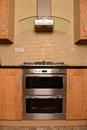 Front modern stainless steel oven new kitchen wood cabinets Royalty Free Stock Photos