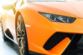 Front of an orange sport luxury car in sunset Royalty Free Stock Photo