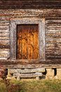 Front porch, door of old rustic log house or cabin Royalty Free Stock Photo