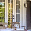 Front porch of a home with chairs and glass window Royalty Free Stock Photo