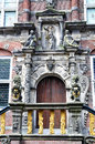 Front of a renaissance building with symbolic relief decorations dutch in bolsward decorated ornaments like bible anchor balance Stock Photography
