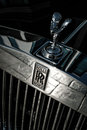 Front of the rolls royce car with logo and spirit ecstasy bonnet ornament photographed in low depth field Stock Image