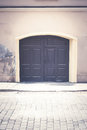 Front side of old house with double wooden door Royalty Free Stock Photo