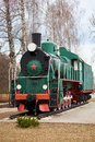 Front side view of classic old green soviet steam locomotive with red star Royalty Free Stock Photo