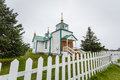 Front of tiny rural russian orthodox church ninilchik alaska entrance to the country in Stock Photo