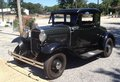 Front View of black 1940's Ford antique car. Royalty Free Stock Photo