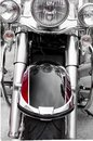 Front side of classic motorcycle/ Chrome and black paint motorcycle/ Classic chopper with big headlights and chrome plate Royalty Free Stock Photo