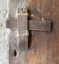 Front view closeup of a wooden aged latch, and keyhole Royalty Free Stock Photo