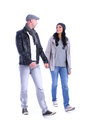 Front view of going young couple walking man and woman girl and guy in jacket and jeans together isolated over white background Stock Photos
