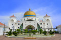 Front view of malacca straits mosque malaysia june is also known as s floating as it is built on stilts above the sea it Royalty Free Stock Photo
