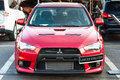 Front view of mitsubishi red car new modern lancer evolution at auto salon Stock Photos