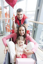 Front on view of mother and young daughter in trolley with father pushing Stock Photography