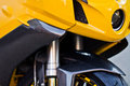 Front view of a motorbike yellow motorcycle with bumper made carbon Royalty Free Stock Images