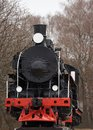 Front view of old classic black steam locomotive with red decoration Royalty Free Stock Photo