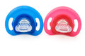 Front view red and blue pacifiers on white with clipping path Stock Photography
