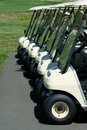 Front view of a row of golf carts Stock Image