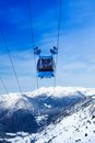 Front view of ski lift cable car with valley and mountains on the background Royalty Free Stock Images